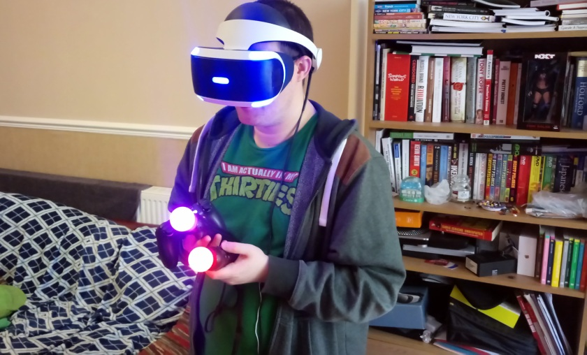 Look how cool as fuck I am here. Actually, this is me trying to grab a screenshot with the Share button on the Dualshock 4 while trying to play a game that uses both Move controllers. I look a prize weapon