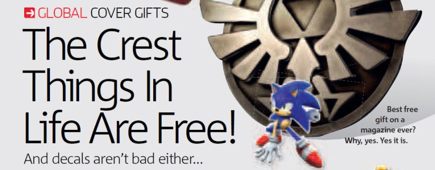 Issue 23 - The free gift that month was a metal Zelda Hylian crest pin badge, you see